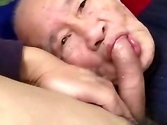 Chinese old man sucking lollipop & getting fucked