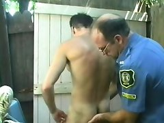 Naughty police officer exchanging oral pleasures with his gay partner