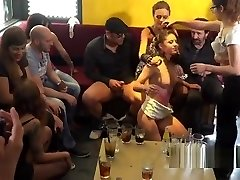 Public slave fellates and pokes in crowd