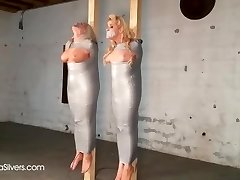 two Busty MILF Trussed & gagged taped up