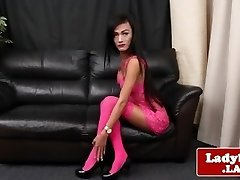 Lingeried ladyboy spreads culo and tugs solo