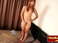 Youthful petite thai tgirl models her booty