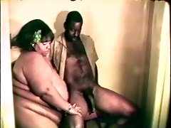 Meaty fat gigantic black bitch enjoys a hard black cock between her lips and legs