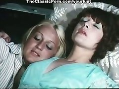Two lesbos Cathy Stewart, Diane Dubois fondle each other and poke cunts with toys