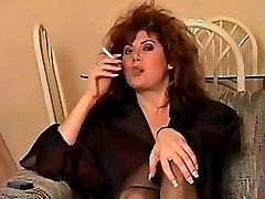 Classic early 90's smoking with large hair, perfect.