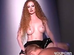 Hot redhead pulverizes a guy