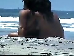 Nude couple at the beach