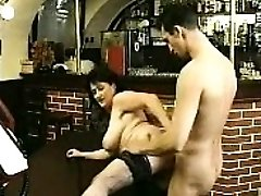 Brunette in stockings inhales giant cock and fucks it