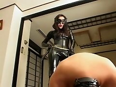 Asian spandex catsuit domina whipping her slave stiff and steamy wax in the end