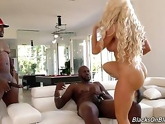 Faux tittied blond cougar Nikki Delano is fucked hard by two black studs