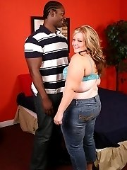 Fat blonde chick lets a black hunk bang her cunt
