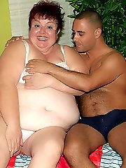 Massive redhead BBW Louise spreads her enormous thighs wide to let a hunk eat out and fuck her...