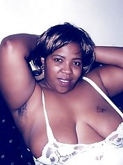 Sandra is a sexy black woman who likes to get wild on the couch.  Cum watch her plop out those big natural titties while doing a sexy little strip tease