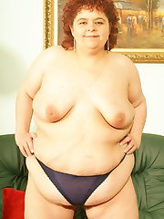 Mature plumper slowly stripping off her clothes to show off her belly and get in a hot threesome