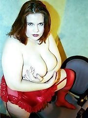 Pretty spread amateur redhead in stockings