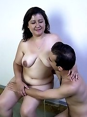 Mature brunette's fat pussy gets fucked