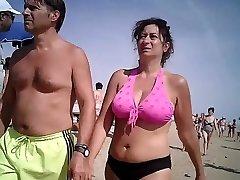 Big breasts in bikini mature at beach