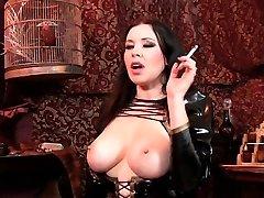 Smoking and displaying big tits