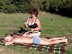 Brunette Plus-size-Milf Outdoors by Young Guy
