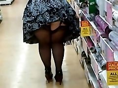 Giant Woman In Pantyhose And Heels Shopping