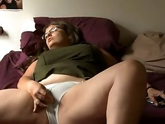 Plus-size girl with glasses masturbates