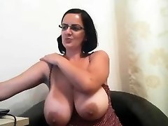Milf with glasses shows her big funbags