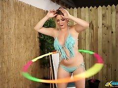 Busty MILF Penny L hula hooping totally naked