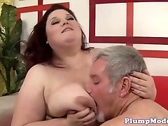 Redhead BBW with massive orbs gets poked