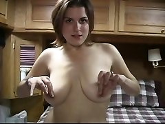 Horny dark haired with phat tits plays with her pussy on her sofa