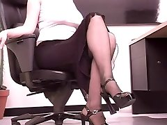 Busty brunette secretary plays with a big fuck stick at her desk