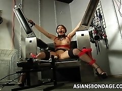 Busty black-haired getting her raw pussy machine fucked