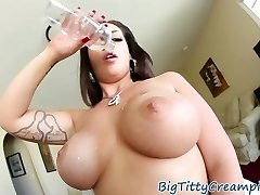 Tattooed milf tittyfucks huge cock