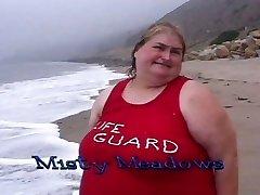Yam-sized lifeguard tarts eat food on the beach