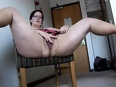 Huge-chested mature BBW in stocking and mini skirt