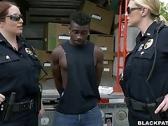 Caucasian police ladies fucks ebony scofflaw in 3some