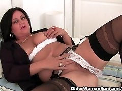 Mature Mommy Masturbates In Stocking And Crotchless Panties