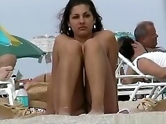 A voyeur seizing pussies and bumpers of girls on a nude beach