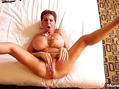 Chesty Euro GILF squirts on a young manstick