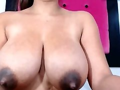 Good-sized natural tits with dark nipples some milk dump