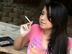 Holding a cigarette and taunting her friend
