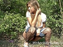 Unshaved woman Riana S enjoys her walk outside