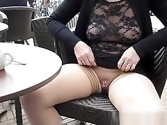 Showing pierced pussy and boobs in cafe