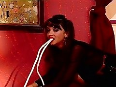Horny babe inserts enema inside her slit