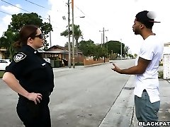 Black scofflaw boinked by two horny white cops