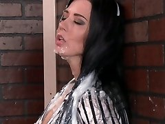 Muddy bitch sucking huge sex toy thru the gloryhole
