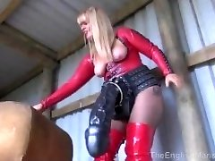Dom showing off her large fake penises to sissy
