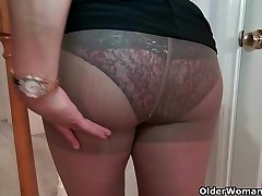 Busty milf Mia Jones strips off and ravages a fake penis