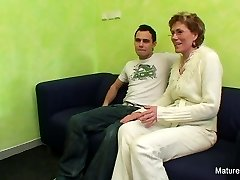 Granny sees porn before getting fucked by a younger stud