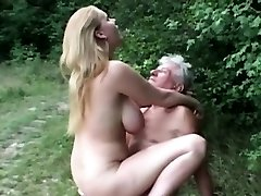 Natural immense titted super-bitch fucks grandpa in the woods