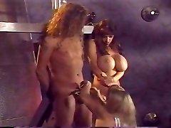 Busty dominatrix has joy with her slaves